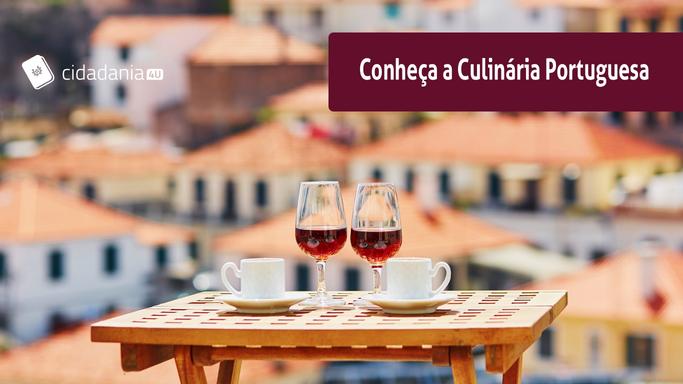 mesa com vinhos e vista de portugal ao fundo